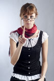 Blonde girl with glasses, pen and book Stock Images