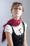 Blonde girl with glasses, pen and book Royalty Free Stock Photos
