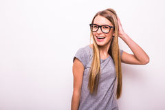 Blonde girl in glasses on white background Royalty Free Stock Photos