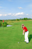 Blonde girl golf player Stock Photo