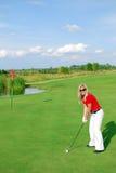Blonde girl golf player Stock Photo