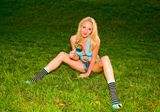 Blonde girl on the grass Stock Photo