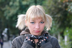 Blonde girl with grey eyes. Portrait of a blonde girl with grey eyes Stock Images