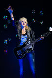 Blonde girl with guitar Royalty Free Stock Photo