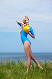 Blonde girl gymnast outdoors Stock Photography