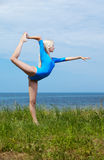 Blonde girl gymnast outdoors Stock Images