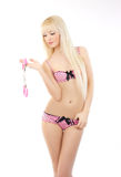 Blonde girl with handcuffs wearing pink lingerie Stock Photography