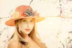 Blonde girl with hat Stock Photography