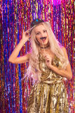 Blonde girl having fun on party Stock Images