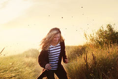Blonde girl having fun. Blonde girl running in the dunes stock photography