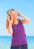 Blonde girl with headphone Stock Photography