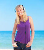 Blonde girl with headphone Stock Images