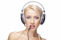 Blonde girl with headphones Stock Image