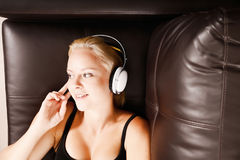 Blonde Girl with Headphones Stock Photography
