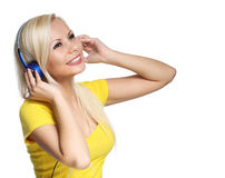 Blonde Girl with Headphones isolated on white. Young DJ Royalty Free Stock Photography
