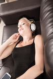 Blonde Girl with Headphones Stock Photo