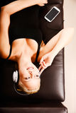 Blonde Girl with Headphones Royalty Free Stock Images