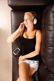 Blonde Girl with Headphones Stock Photos
