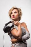 Blonde girl with headphones Stock Image