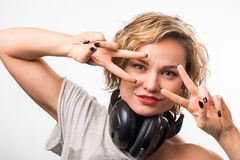 Blonde girl with headphones Royalty Free Stock Photos