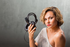 Blonde girl with headphones Stock Images