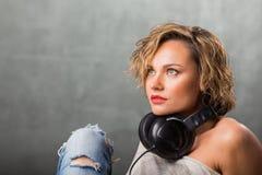 Blonde girl with headphones Stock Photo