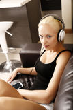 Blonde Girl with Headphones Royalty Free Stock Photo