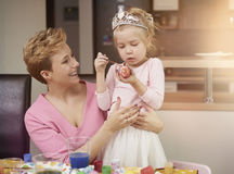 Blonde girl with her mom Royalty Free Stock Photo