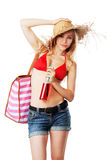 Blonde girl on her way to the beach Royalty Free Stock Photo