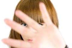 Blonde girl hiding. Behind her palm, isolated on white background Stock Image