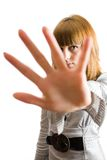 Blonde girl hiding. Behind her palm, isolated on white background Royalty Free Stock Image