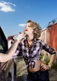 Blonde girl hitchhiker Stock Photo