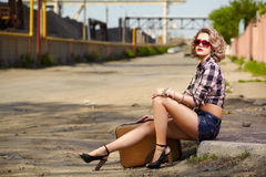 Blonde girl hitchhiker Stock Images