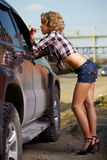 Blonde girl hitchhiker Royalty Free Stock Photography