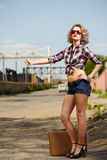 Blonde girl hitchhiker stock photography