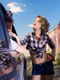 Blonde girl hitchhiker Stock Image