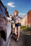 Blonde girl hitchhiker Royalty Free Stock Images