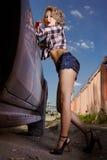 Blonde girl hitchhiker stock photo