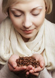 Blonde girl hold coffee beans in hands Stock Photography