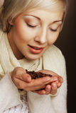 blonde girl hold coffee beans in hands Royalty Free Stock Images