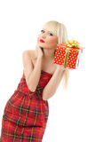 Blonde girl holding christmas gift in red dress. Beautiful young blonde girl holding christmas gift in red dress on white background Royalty Free Stock Photo