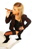 Blonde girl holding cigar Royalty Free Stock Image
