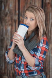 Blonde girl holding cup Royalty Free Stock Images