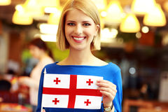 Blonde girl holding flag of Georgia Stock Photos