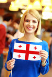 Blonde girl holding flag of Georgia Royalty Free Stock Photo