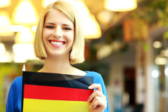 Blonde girl holding flag of Germani Royalty Free Stock Image