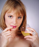 Blonde girl holding a glass of wine Royalty Free Stock Photos