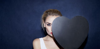 Blonde girl holding heart. Stock Photo