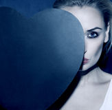 Blonde girl holding heart. Stock Photography