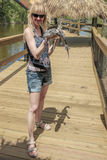 Blonde girl with alligator Royalty Free Stock Photo